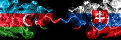 Azerbaijan, Azerbaijani vs Slovakia, Slovakian smoky mystic flags placed side by side. Thick colored silky abstract smoke flags
