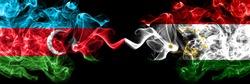 Azerbaijan, Azerbaijani vs Tajikistan, Tajikistani smoky mystic flags placed side by side. Thick colored silky abstract smoke flags