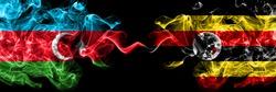 Azerbaijan, Azerbaijani vs Uganda, Ugandan smoky mystic flags placed side by side. Thick colored silky abstract smoke flags