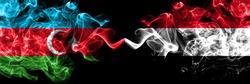 Azerbaijan, Azerbaijani vs Yemen, Yemeni smoky mystic flags placed side by side. Thick colored silky abstract smoke flags
