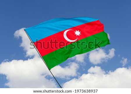 Azerbaijan flag isolated on sky background with clipping path. close up waving flag of Azerbaijan. flag symbols of Azerbaijan.