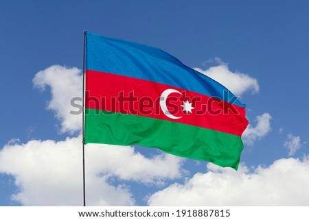 Azerbaijan flag isolated on the blue sky with clipping path. close up waving flag of Azerbaijan. flag symbols of Azerbaijan.