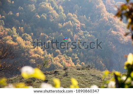 Azerbaijan flag,Waving flag on the mountain. National flag of Azerbaijan on strong wind in the sunny day. Outdoor nature shot