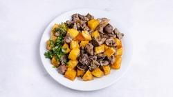 Azerbaijan food ciz biz - roasted lamb entrails with roasted potatoes