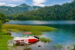 Azerbaijan, Goygol: Panoramic view landscape scenery on famous Lake  near Ganja and boat