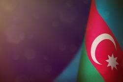 Azerbaijan hanging flag for honour of veterans day or memorial day on blue dark velvet background. Azerbaijan glory to the heroes of war concept.