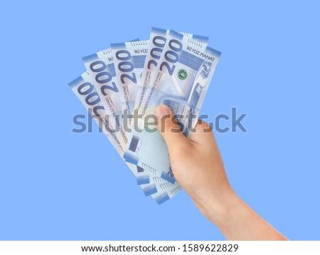 Azerbaijan money manat 200 azn background and hand