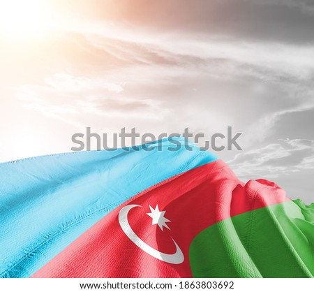 Azerbaijan national flag cloth fabric waving on beautiful background.