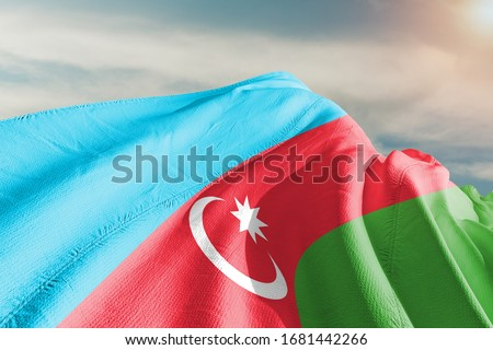 Azerbaijan national flag cloth fabric waving on beautiful sky.