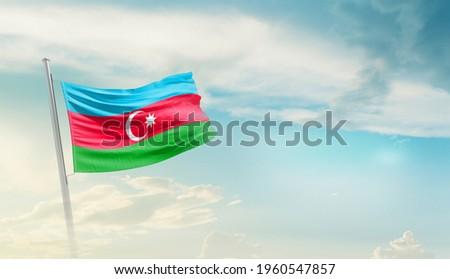 Azerbaijan national flag waving in beautiful sky.