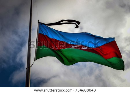 Azerbaijan's three-color national flag with black ribbon on top and raised every year in front of Alley of Martyrs on January 20.  #754608043