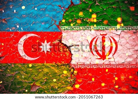azerbaijan vs iran flags painted over cracked concrete wall.And lava flows behind. azerbaijan vs iran war.