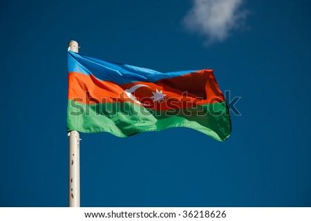 Azerbaijani flag against blue sky