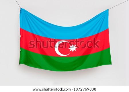 Azerbaycan Bayrağını Asmak. Translation: Hanging the Azerbaijan Flag, isolated Stok fotoğraf ©