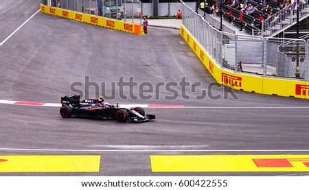 AZERBAYJAN, BAKU -17 JUNE, 2016 : FORMULA 1, GRAND PRIX OF EUROPE race car racing at high speed on speed track with motion blur #600422555
