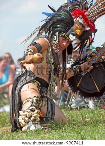 Aztec fire dancer with leg in flame at Pow Wow