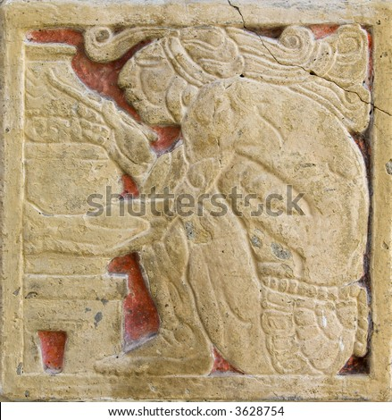 Aztec style wall decoration with craftsman on terracotta background