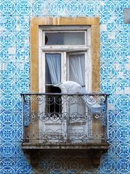 Azulejos facade on historic building in Lisbon, Portugal