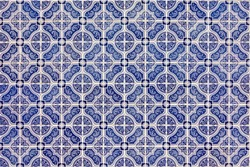 Azulejos is traditional Portuguese tiles. Azulejo is a form of Portuguese or Spanish painted, tin-glazed, ceramic tile work. Architecture ornament.