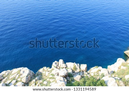 Azure Adriatic sea and rocky shore