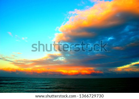 Azure sky with amazing clouds over the Adriatic sea during a very colorful sunset