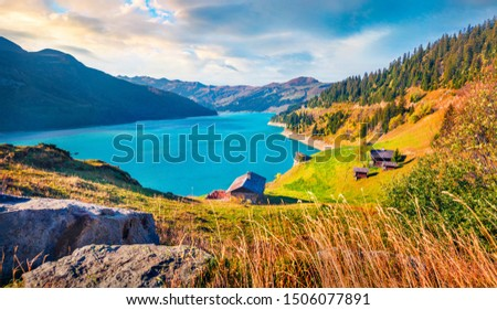 Azure waters of Roselend lake. Last warm days on Auvergne-Rhone-Alpes, France, Europe. Beauty of nature concept background. #1506077891
