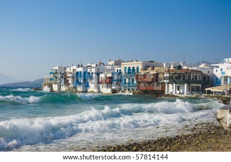 Azure waves with white sea  foam around Little Venice on Mykonos. Greece