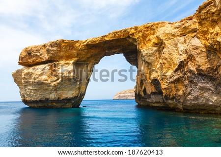Azure Window famous stone arch of Gozo island in the sun in summer Malta