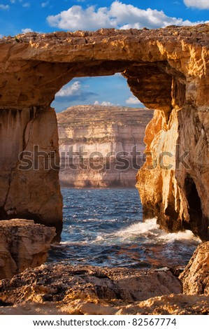 Azure window, natural stone arch by Dwejra cliffs at western  Gozo island, Malta - stock photo
