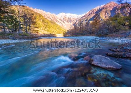 Azusa River flowing through Kamikochi in Nagano Prefecture, Japan. The autumn leaves season is beautiful. #1224933190