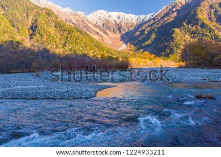 Azusa River flowing through Kamikochi in Nagano Prefecture, Japan. The autumn leaves season is beautiful. #1224933211