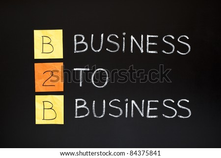 B2B acronym - BUSINESS TO BUSINESS. Concept made with sticky notes and white chalk on a blackboard.