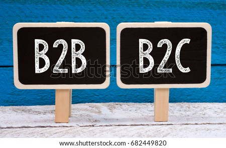 B2B and B2C Business - two little chalkboards with text on blue wooden background