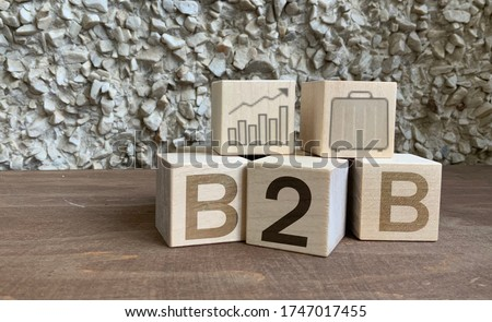 B2B, Wooden cubes with the abbreviation B2B, business and financial concept, B2B marketing . Stockfoto ©