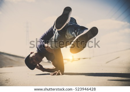 B-boy doing some stunts - Street artist breakdancing outdoors