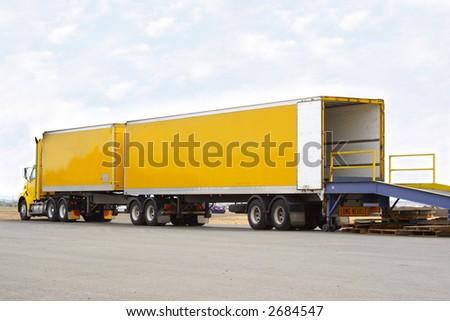 B double truck backed onto loading dock