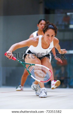 B.JALIL, MALAYSIA - MARCH 16: Dipika Pallikal (India) in pink takes on Samantha Teran (Mexico) at the CIMB KL Open Squash Championship 2011 at the National Squash Centre. on March 16, 2011 in Malaysia.