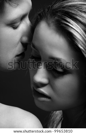 B&W close up portrait of a passionate couple