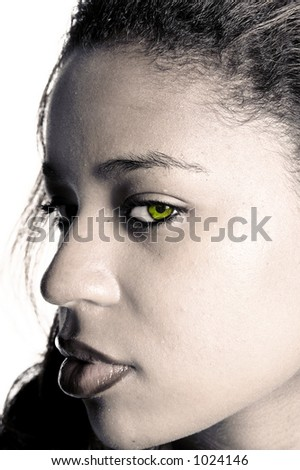 B&W conversion of a close up of a pretty African American girl with a green eye