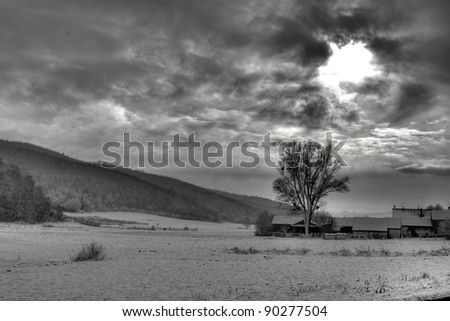 B/W photo of dramatic sky, and sun rays through the clouds