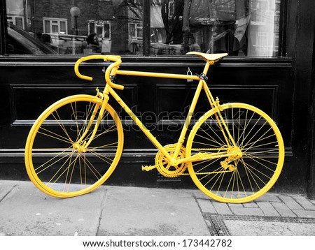 B&Amp;W Photo Of Old Yellow Bike On The Window Of The Coffee Shop