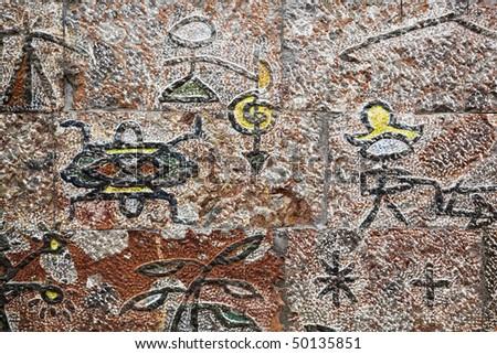 ba dong pictograph of the naxi people (a minority ethnic group) on wall, lijiang, yunnan, china.