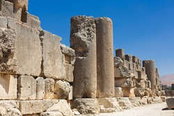 Baalbek temple complex in Lebanon. Ancient massive Roman ruins. View of the columns and old stone walls on the background of clear blue sky