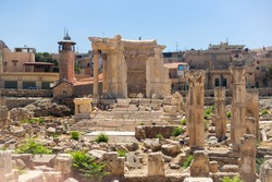 Baalbek temple complex in Lebanon. Massive Roman ruins. View of the columns and the Temple of Venus on the background of the modern city.