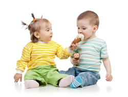 babies girl and boy eating ice cream together in studio isolated