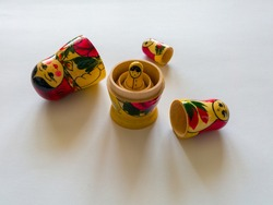 Babushka or Matryoshka is a Russian wooden toy consisting of folding dolls and inside which are smaller dolls.