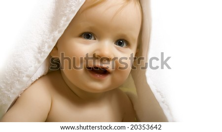 Baby after bath. Cheerful child