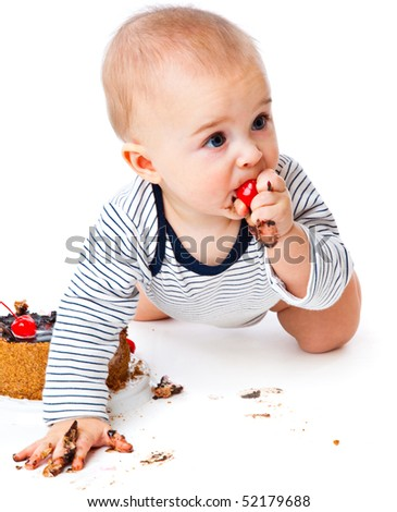 Baby and cake. Isolated on white background