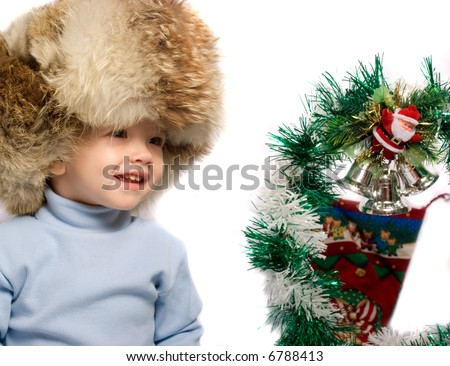 Baby and christmas decoration - stock photo
