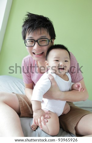 Baby and Father Happy Smile Face with green home background, Model are asian family